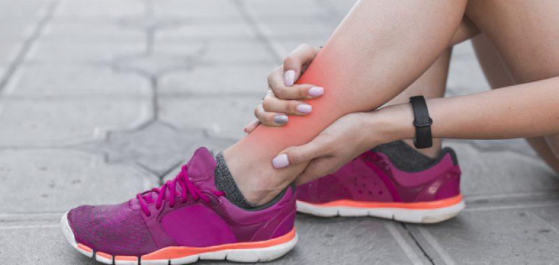 female-athlete-having-ankle-injury-sitting-pavement_23-2147888984